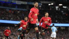 Indosport - Selebrasi Marcus Rashford usai unggulkan Manchester United atas Manchester City dalam pertandingan Liga Inggris 2019-2020 pekan ke-16 di Etihad Stadium