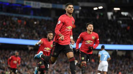 Bintang Manchester United, Marcus Rashford melakukan aksi mulia yang membuat Liverpool dan Manchester City bangga dengan perbuatannya. - INDOSPORT