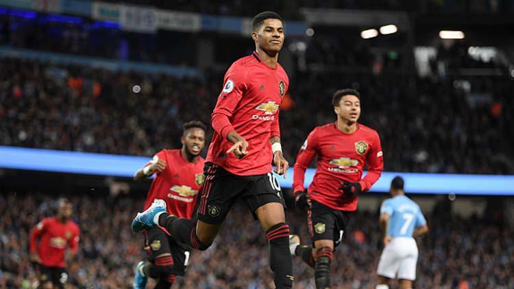 Selebrasi Marcus Rashford usai unggulkan Manchester United atas Manchester City dalam pertandingan Liga Inggris 2019-2020 pekan ke-16 di Etihad Stadium Copyright: Michael Regan/GettyImages