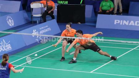 Kerja sama Praveen Jordan/Melati Daeva, ganda campuran Indonesia saat melawan Tan Kian Meng/Lai Pei Jing (Malaysia) di semifinal SEA Games 2019. - INDOSPORT