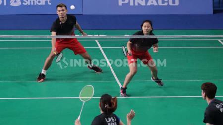 Rinov Rivaldi/Phita Haningtyas Melati vs Goh Soon Huat/Lai Shevon Jemie di semifinal SEA Games 2019. - INDOSPORT
