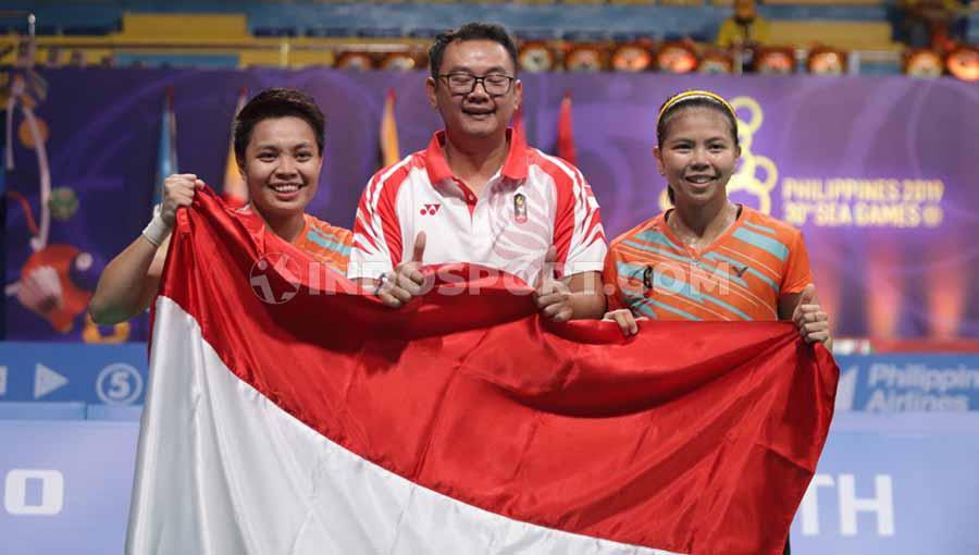 Pasangan Ganda putri Indonesia, Greysia Polii/Apriyani Rahayu berhasil mengalahkan pasangan Ganda putri Malaysia Chayanit Chaladchalam/Phataimas Muenwong, di SEA Games 2019, Senin (09/12/19). Copyright: Ronald Seger Pprabowo/INDOSPORT