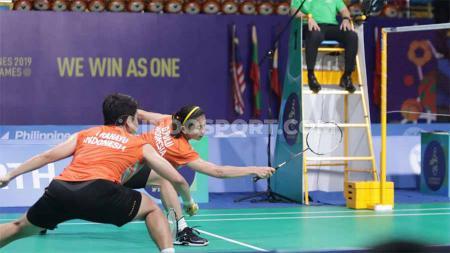 Pasangan ganda putri Indonesia, Greysia Polii/Apriyani Rahayu membongkar kekuatan lawannya usai berhasil menggenggam tiket Perempat Final Malaysia Masters 2020. - INDOSPORT