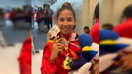 Atlet taekwondo Timor Leste, Amorin Imbrolia Araujo dos Reis, sukses mempersembahkan medali perunggu di cabang Taekwondo SEA Games 2019. - INDOSPORT
