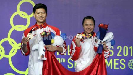 Praveen Jordan/Melati Daeva sukses meraih emas ganda campuran SEA Games 2019 bagi Indonesia dari cabang olahraga bulutangkis. - INDOSPORT