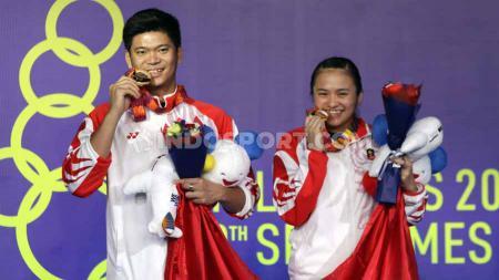 Kesuksesan tim bulutangkis Indonesia mempersembahkan medali emas di turnamen SEA Games 2019 membuat wakil Tanah Air diguyur bonus yang fantastis. - INDOSPORT