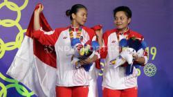 Ganda putri Indonesia, Greysia Polii/Apriyani kalahkan wakil Thailand dan rebut medali emas SEA Games 2019.