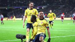 Indosport - Selebrasi pemain Arsenal usai berhasil mengembalikan kedudukan atas West Ham United dalam pertandingan Liga Inggris 2019-2020 pekan ke-16 di London Stadium