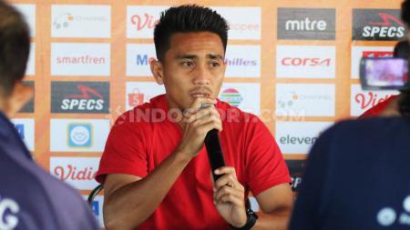 Gelandang Bali United, M Taufiq, masih menanti hasil diskusi terkait permohonan klub untuk melakukan perubahan kontrak pemain saat Liga 1 2020 dilanjutkan. - INDOSPORT