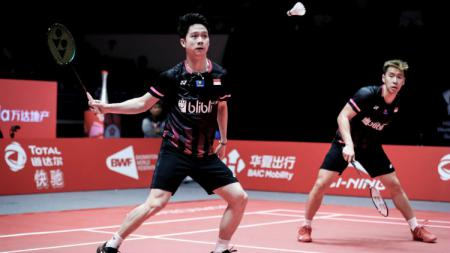 Kevin Sanjaya Sukamuljo dan Marcus Fernaldi Gideon disebut tak harmonis oleh media Taiwan kala takluk di semifinal BWF World Tour Finals 2019, Sabtu (14/12/19). - INDOSPORT