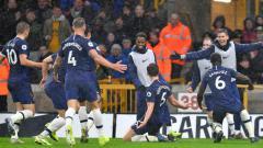 Indosport - Selebrasi pemain Tottenham Hotspur merayakan kemenangannya atas Wolves.
