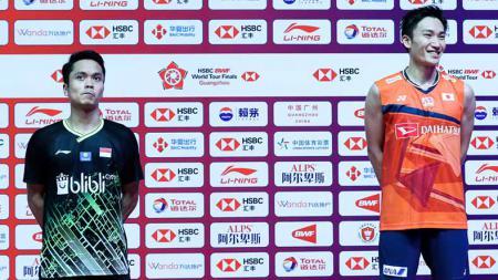 Eks pelatih bulutangkis Denmark, Steen Schleicher, bertanya-tanya usai Anthony Sinisuka Ginting tak berhasil mengalahkan Kento Momota (Jepang) di partai final BWF World Tour Finals 2019, Minggu (15/12/19). - INDOSPORT