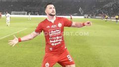 Indosport - Penyerang Persija Jakarta Marko Simic sukses menjadi top skor Liga 1 2019 dengan selisih 10 gol dari Beto Goncalves.