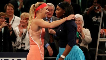 Caroline Wozniacki bersama dengan Serena Williams akan bermain di sektor ganda putri. - INDOSPORT