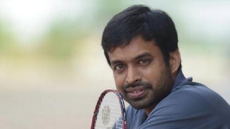 Pullela Gopichand, legenda hidup sekaligus kepala pelatih Asosiasi Bulutangkis India (BAI), mengharapkan Olimpiade ditunda akibat virus corona. - INDOSPORT