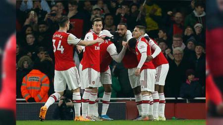 Selebrasi pemain Arsenal usai Nicolas Pepe mencetak gol dalam lanjutan Liga Inggris melawan Manchester United, Kamis (02/01/19) dini hari WIB. - INDOSPORT