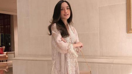 Selebgram sekaligus beauty bloger asal Indonesia, Cindy Priscilla menarik perhatian warganet saat melakukan swatafoto usai workout. - INDOSPORT