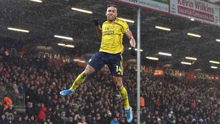 Pandemi virus corona bisa memaksa Pierre-Emerick Aubameyang untuk memperpanjang kontrak di Arsenal. - INDOSPORT
