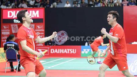 Ganda putra Korea Selatan, Lee Yong-dae/Kim Gi-jung, mengalahkan pasangan China, Li Jun Hui/Liu Yu Chen, pada babak pertama Indonesia Masters 2020 di Istora Senayan, Rabu (15/01/20). - INDOSPORT