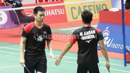 Pebulutangkis ganda putra, Hendra Setiawan/Mohammad Ahsan berhasil mengalahkan wakil China Taipei, Lu Ching Yao/Yang Po Han di babak 16 besar Indonesia Masters. - INDOSPORT