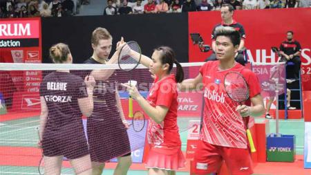Ganda campuran Prancis, Thom Gicquel/Delphine Delrue, kalahkan Praveen Jordan/Melati Daeva Oktavianti di perempat final Indonesia Masters 2020, Jumat (17/1/20). - INDOSPORT
