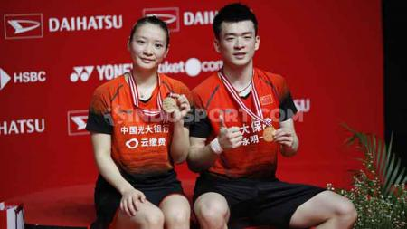 Zheng Siwei/Huang Yaqiong sukses menjadi juara Indonesia Masters 2020 usai kalahkan rekan senegara. - INDOSPORT