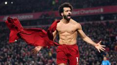Indosport - Mohamed Salah terlihat begitu emosional ketika merayakan gol ke gawang Manchester United dalam lanjutan pekan ke-23 Liga Inggris 2019-2020, Minggu (19/1/20).