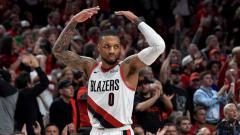 Indosport - Damian Lillard, pemain bintang basket NBA dari tim Portland Trail Blazers.