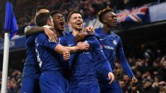 Indosport - Jorginho (tengah) merayakan golnya ke gawang Arsenal