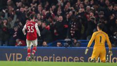 Indosport - Selebrasi Gabriel Martinelli usai mencetak gol ke gawang Kepa dalam laga Liga Inggris Chelsea vs Arsenal