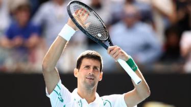 Novak Djokovic selebrasi usai menang mudah atas Yoshihito Nishioka, 6-3, 6-2, 6-2. - INDOSPORT