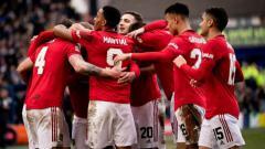 Indosport - Phil Jones merayakan gol saat pertandingan Piala FA Tranmere Rovers vs Manchester United, Minggu (26/01/20) malam WIB