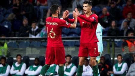 Bruno Fernandes dan Cristiano Ronaldo saat membela Timnas Portugal - INDOSPORT