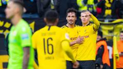 Indosport - Mats Hummels merayakan gol bersama Erling Haaland di laga Bundesliga antara Borussia Dortmund vs 1 FC Union Berlin