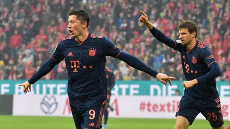 Robert Lewandowski merayakan golnya di laga Mainz 05 vs Bayern Munchen - INDOSPORT