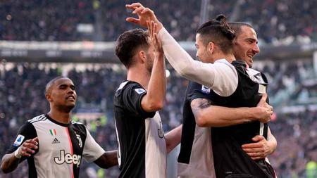 Rencana penuh resiko Cristiano Ronaldo melibatkan tukar pemain dengan Barcelona bisa berimbas kehancuran Juventus selaku timnya saat ini. - INDOSPORT