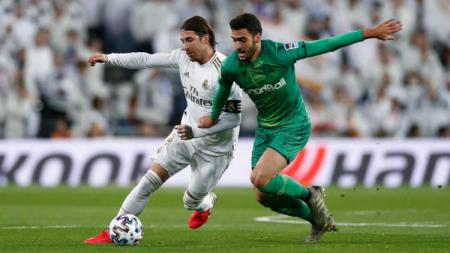 Aksi Sergio Ramos dalam pertandingan perempatfinal Copa del Rey Real Madrid vs Real Sociedad, Jumat (07/02/20). - INDOSPORT