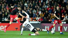 Indosport - Terdapat pergerakan di tabel klasemen LaLiga Spanyol selepas dua laga terkini, Granada vs Getafe dan Valencia vs Levante, Sabtu (13/6/20) dini hari WIB.