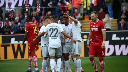 Selebrasi para pemain Bayern Munchen usai cetak gol ke gawang FC Koln. - INDOSPORT