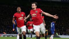 Indosport - Willian dan Anthony Martial di laga Liga Inggris antara Chelsea vs Manchester United.