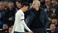 Indosport - Son Heung-min (kiri) dan Jose Mourinho, pemain dan pelatih klub Liga Inggris, Tottenham Hotspur.