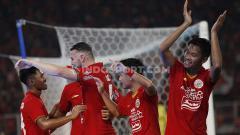 Indosport - Selebrasi para pemain Persija Jakarta saat melawan Geylang International.
