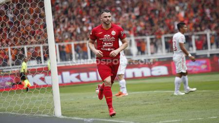 Selebrasi pemain Persija, Marko Simic usai mencetak gol ke gawang Borneo FC pada Liga 1 di Stadion Gelora Bung Karno, Minggu (1/3/20). - INDOSPORT