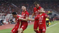 Indosport - Selebrasi beberapa pemain bintang Persija Jakarta ke gawang Borneo FC pada Liga 1 di Stadion Gelora Bung Karno, Minggu (01/03/20).