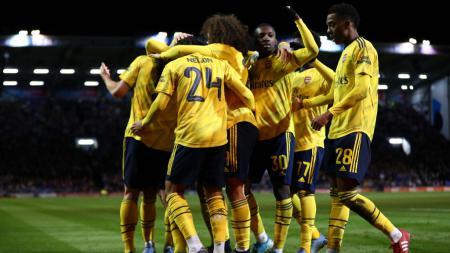 Sokratis Papastathopoulos ikuti langkah Mesut Ozil usai tak lagi dibutuhkan Arsenal dengan resmi gabung Olympiakos. - INDOSPORT