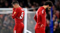 Para pemain Liverpool tertunduk lesu usai kalah dari Chelsea