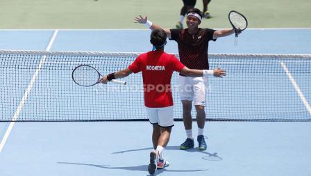 Kemenangan Christopher/David mengamankan posisi Indonesia di grup 2 Piala Davis.