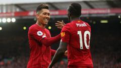 Indosport - Selebrasi Sadio Mane dan Roberto Firmino di laga Liga Inggris antara Liverpool vs Bournemouth.