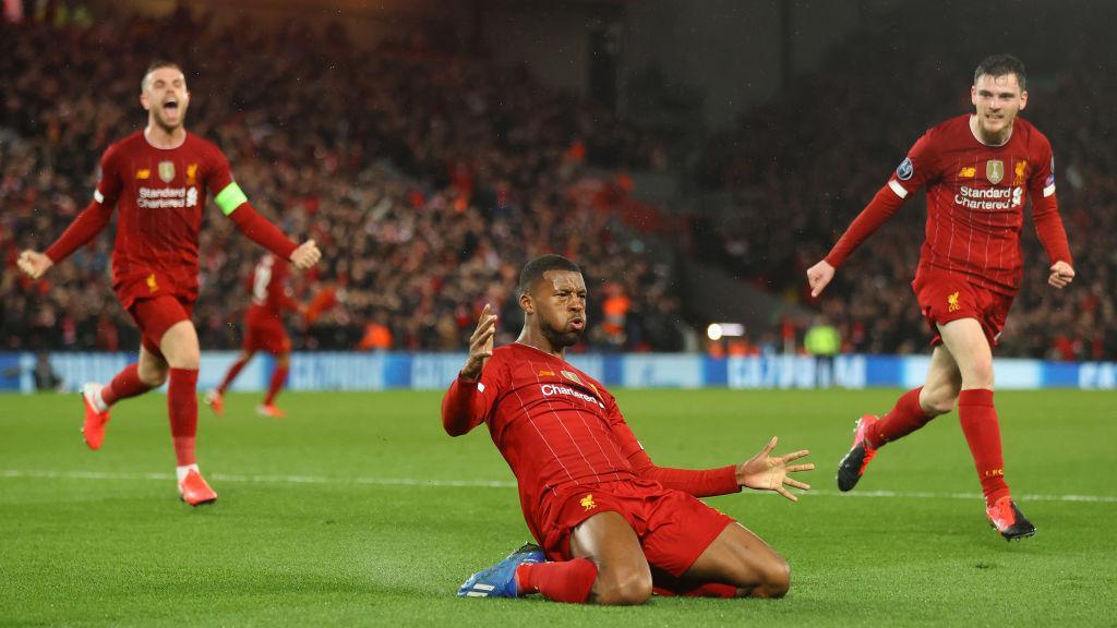 Selebrasi Georginio Wijnaldum usai mencetak gol di laga Liga Champions antara Liverpool vs Atletico Madrid Copyright: Julian Finney/Getty Images