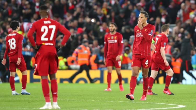 Skuat Liverpool lesu karena disingkirkan Atletico Madrid dari 16 besar Liga Champions 2019/20. Copyright: Alex Livesey - Danehouse/Getty Images